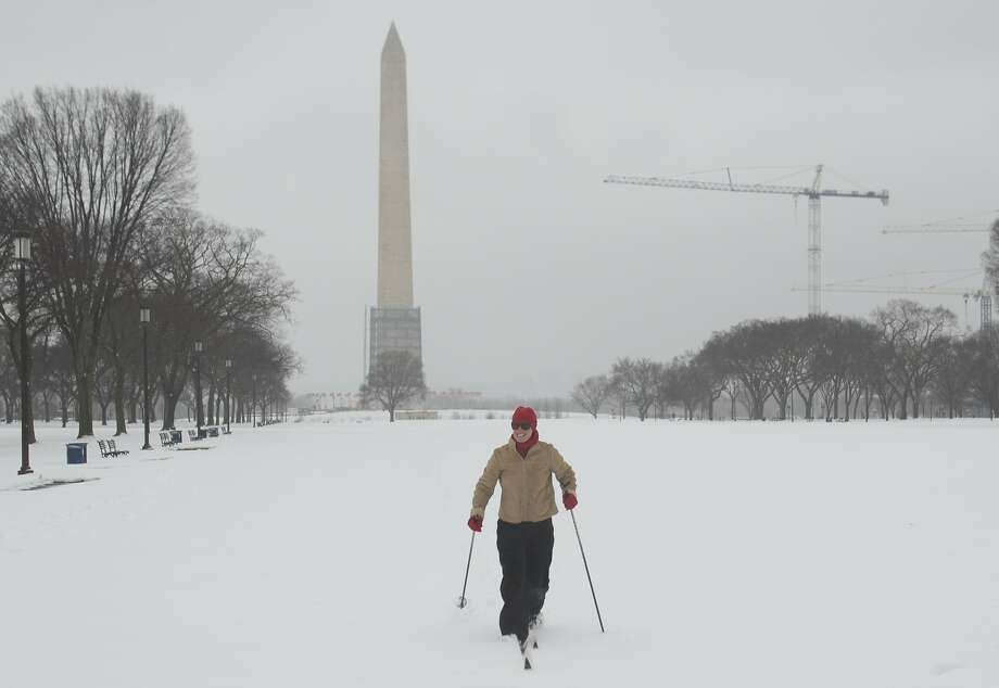 A woman cross-country skis across the National Mall in Washington, D.C., which received at least 8 inches of snow. Photo: Saul Loeb, AFP/Getty Images