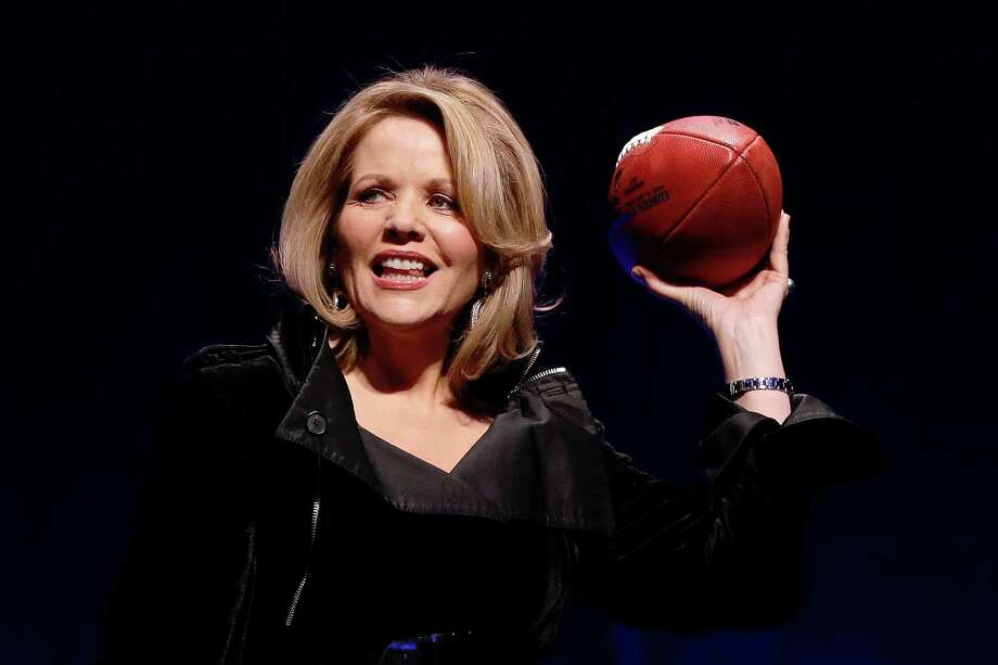 Opera singer Renee Fleming who will sing the National Anthem before the NFL Super Bowl XLVIII football game holds the game ball during a press conference Thursday, Jan. 30, 2014, in New York. (AP Photo)  ORG XMIT: NYDA108 / AP