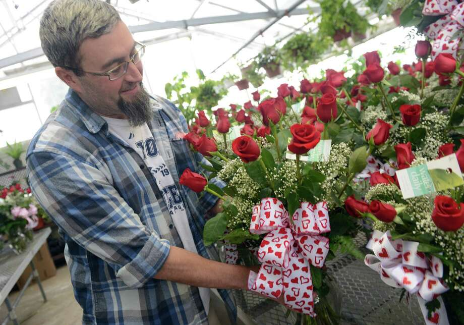 Owner Mark Rempfer gets ready for Valentine's Day Thursday, Feb. 13, 2014, at Langanke's Florist in Shelton, Conn.  The flower shop didn't make any delivers during Thursday's storm but some customers came in to pick up orders and deliveries will go out first thing tomorrow morning. Photo: Autumn Driscoll / Connecticut Post