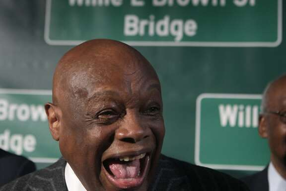 Willie Brown is seen in front of a backdrop with the new freeway sign at a ceremony on Treasure Island to dedicate the renaming of the western Bay Bridge span after Brown in San Francisco, Calif. on Tuesday, Feb. 11, 2014. Caltrans crews will install the signs bearing Brown's name soon.