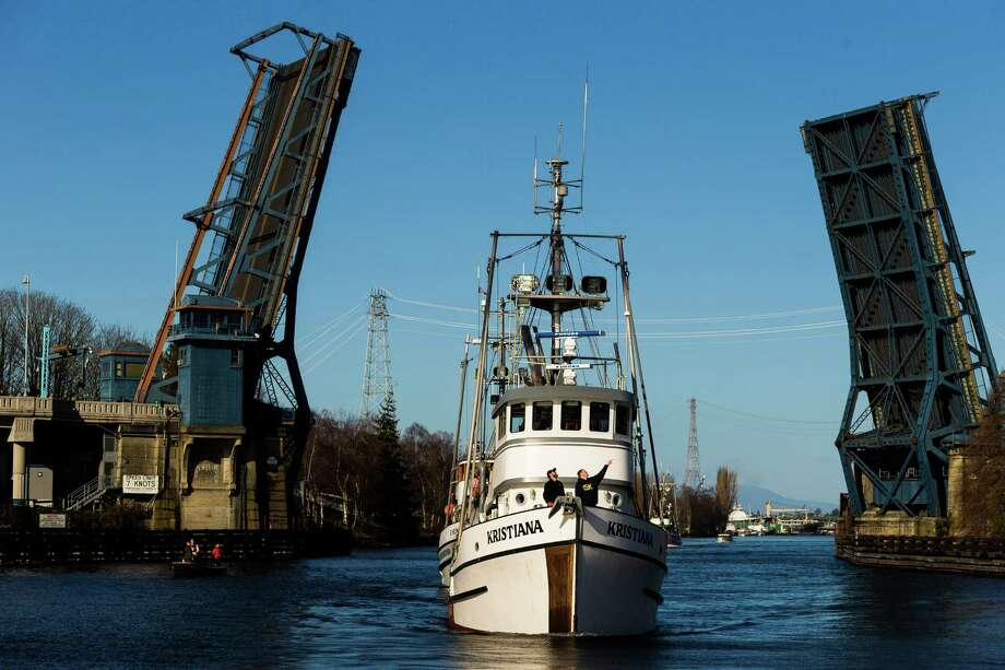 Ships pass under the Fremont Bridge during the Parade of Historic Fishing Schooners Thursday, Feb. 13, 2014, beginning at Fishermen's Terminal and concluding at MOHAI in Seattle. The eight-boat parade consisted only of operational historic wooden fishing schooners - some more than 100 years old - responsible for seafood on dinner tables nationwide. Photo: JORDAN STEAD, SEATTLEPI.COM / SEATTLEPI.COM