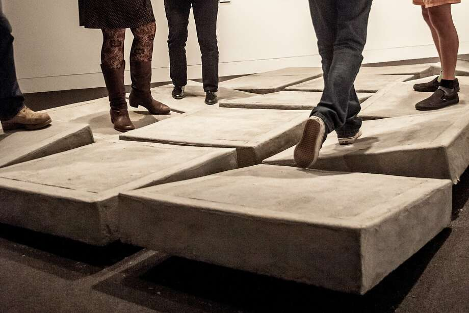 "Anja Ulfeldt's ""Obstacles"" is a platform featuring concrete tiles that tilt in two directions. The tilts, creaks and thuds are amplified. Photo: Courtesy Of The Gallery"