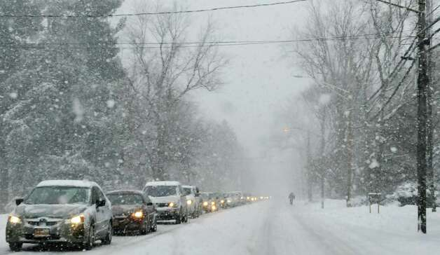 A line of cars on Route 9 head slowly north on Thursday, Feb. 13, 2014 in Loudonville, NY. (Paul Buckowski / Times Union) Photo: Paul Buckowski / 00025747A