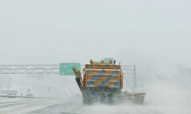 A New York State Department of Transportation snowplow operator clears a lane on Interstate 787 on Thursday, Feb. 13, 2014 in Albany, NY. (Paul Buckowski / Times Union) Photo: Paul Buckowski / 00025747A