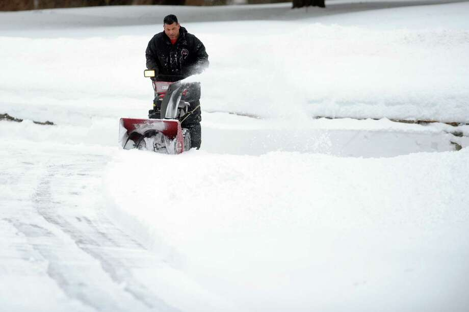 Bob Bavolacco uses a snowblower to clear his driveway Thursday, Feb. 13, 2014, in Shelton, Conn. Photo: Autumn Driscoll / Connecticut Post