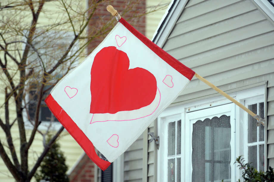 A valentine flag flies following a heavy snow in Stratford, Conn. Feb. 13, 2014. Photo: Ned Gerard / Connecticut Post
