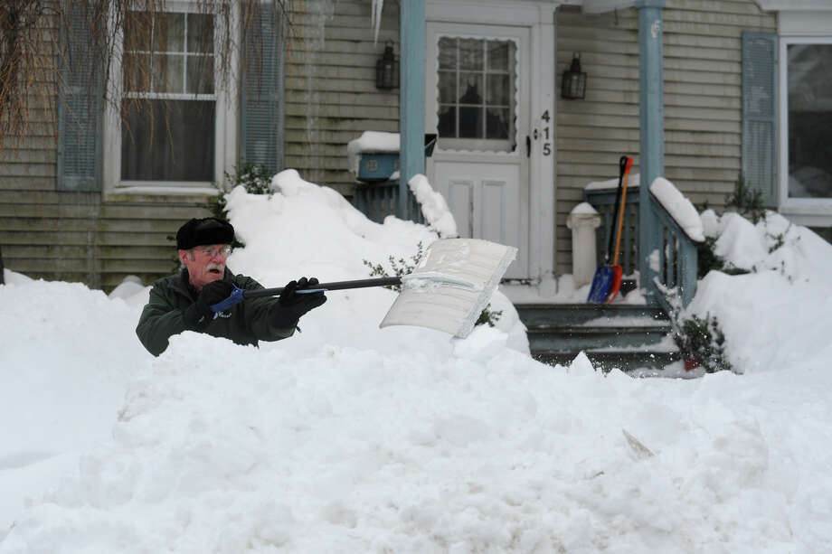 Frank Bender shovels following a heavy snowfall in Stratford, Conn. Feb. 13, 2014. Photo: Ned Gerard / Connecticut Post