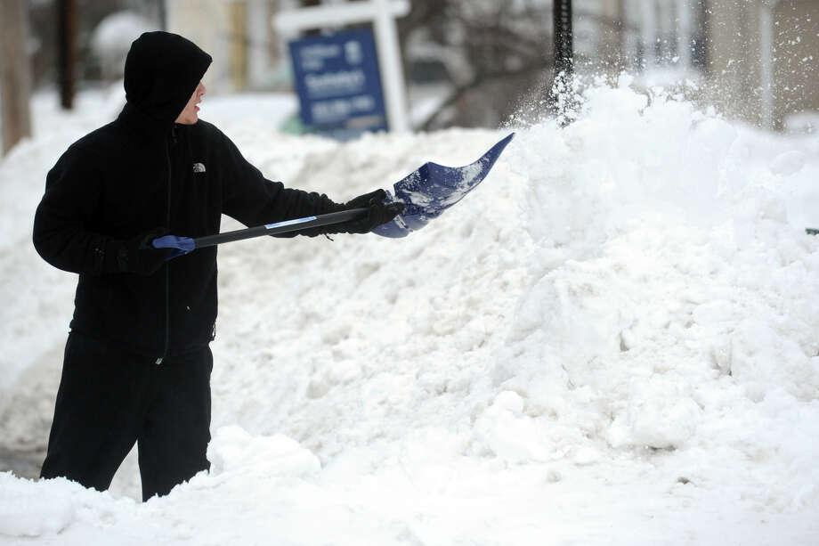 Orlando Segui shovels following a heavy snow in Stratford, Conn. Feb. 13, 2014. Photo: Ned Gerard / Connecticut Post