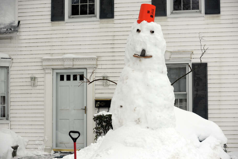 Snowmen come to life following a heavy snow in Stratford, Conn. Feb. 13, 2014. Photo: Ned Gerard / Connecticut Post
