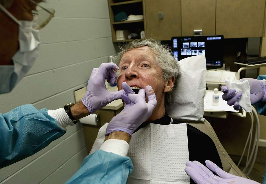 Dr. Walter Tickner of San Leandro fits Jim Begley with Larell One Step Dentures. Photo: Michael Macor, The Chronicle