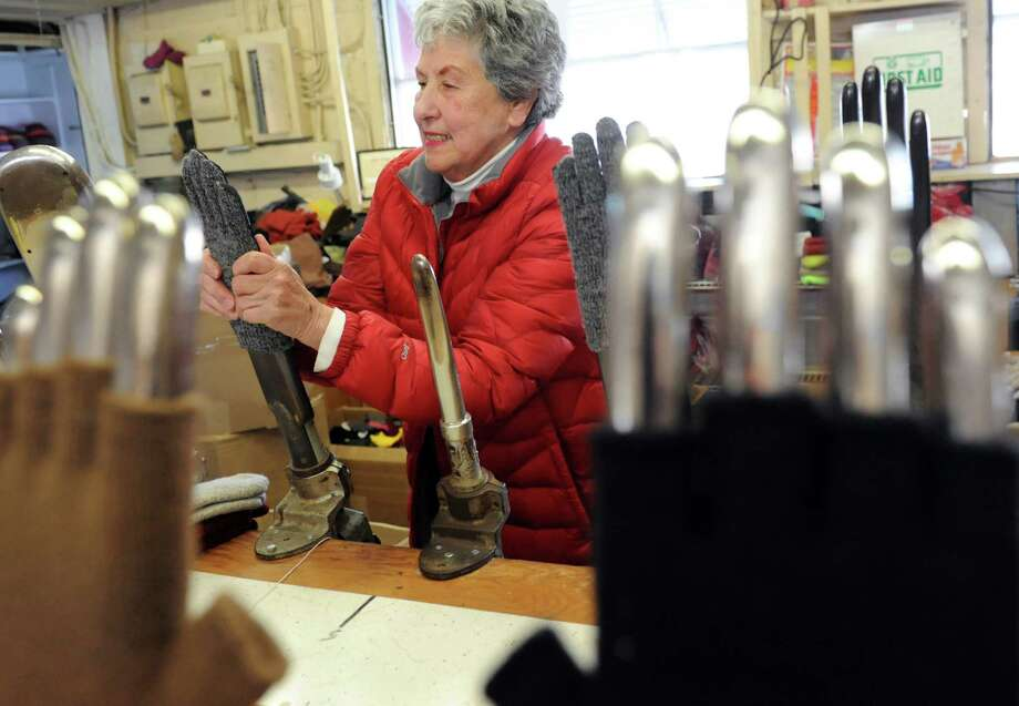 Business owner Nancy Newberry fits gloves on forming irons in the factory on Tuesday, Jan. 28, 2014, at Newberry Knitting Co. Inc. in Rotterdam, N.Y. (Cindy Schultz / Times Union) Photo: Cindy Schultz / 00025528A