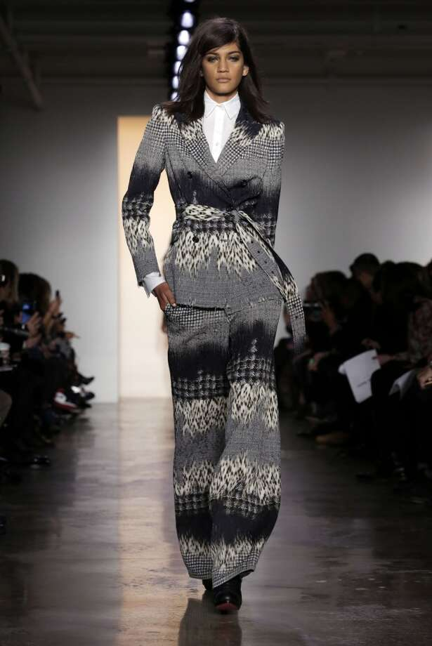 The Peter Som Fall 2014 collection is modeled during Fashion Week in New York,  Friday, Feb. 7, 2014. (AP Photo/Richard Drew) Photo: Richard Drew, Associated Press