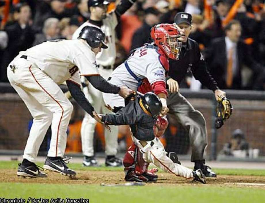 J.T Snow, left, enjoyed a 16-year major league career. A gold glove first baseman, Snow is most well-known for his quick-thinking during the 2002 World Series. There was a play at the plate and Darren Baker, the 3-year old son of San Francisco Giants manager Dusty Baker, ran by home plate to pick up a bat. Snow alertly swiped him by the back of his coat and got him out of harm's way. Photo: Paul Devlin
