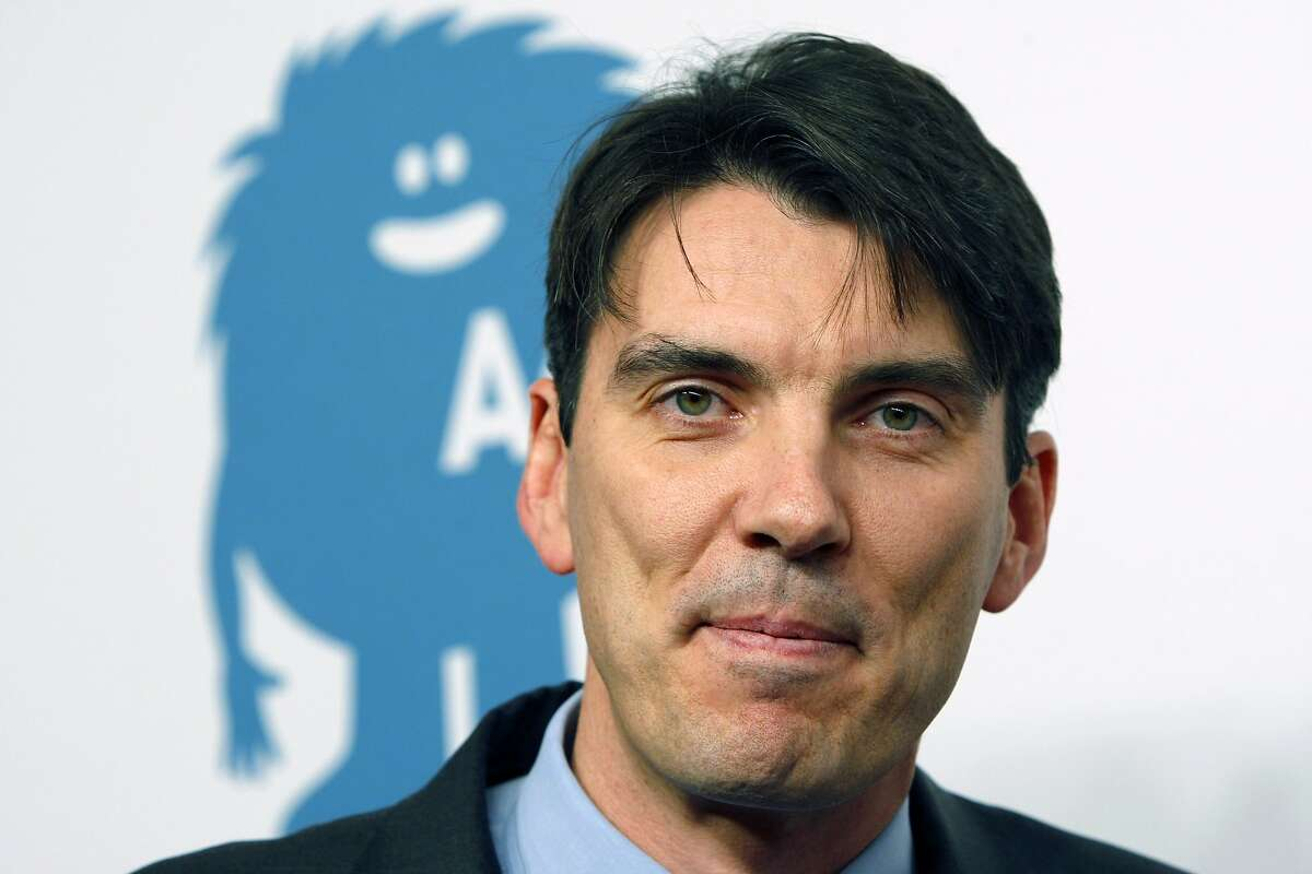 FILE - In this Wednesday, Dec. 9, 2009, file photo, AOL Chief Executive Officer Tim Armstrong poses for a photograph after arriving for a cocktail party kicking off AOL becoming an independent company, at the New York Stock Exchange in New York. Since taking charge in April 2009, Armstrong has revived an ailing company. (AP Photo/Kathy Willens, File)