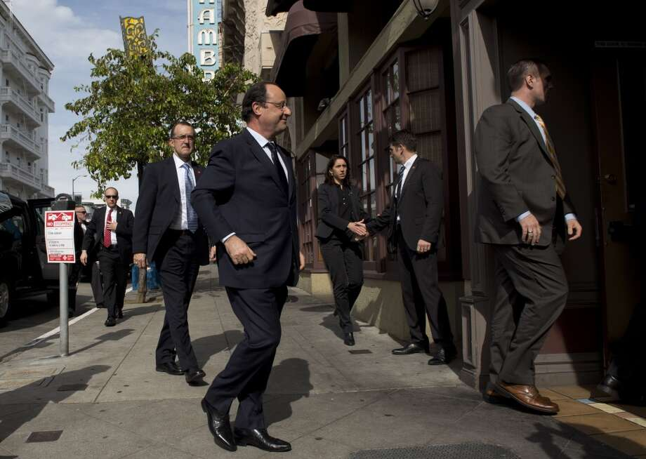 French President Francois Hollande arrives for a lunch with business leaders at La Folie in San Francisco. Hollande was on the last day of a three-day state visit to the United States. Photo: Alain Jocard, AFP/Getty Images