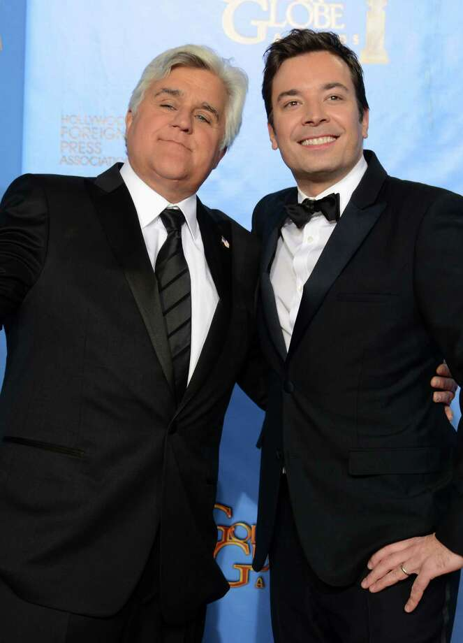 Jay Leno (left) and Jimmy Fallon meet backstage at the Golden Globe Awards. Leno has moved on from late-night TV prominence for NBC, making way for Fallon. Photo: Jordan Strauss / Associated Press / Invision