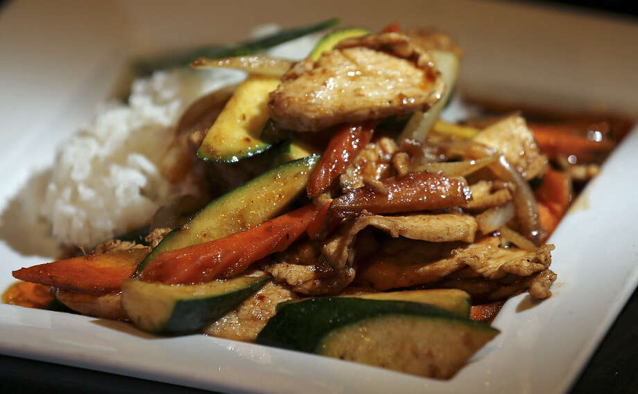 Lemongrass chicken features tender and well-flavored meat with a kick of flavor from an array of vegetables. Photo: Photos By Edward A. Ornelas / San Antonio Express-News / © 2014 San Antonio Express-News