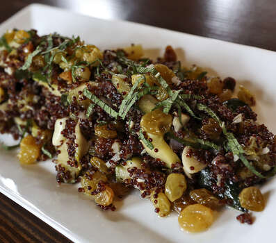 Red quinoa (pronounced KEEN-wah) is the main ingredient in this offering at the  Boiler House Texas Grill & Wine Garden at The Pearl. Photo: Express-News File Photo / San Antonio Express-News