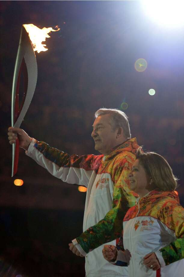 Former Russian figure skater and current politician Irina Rodnina lit the Olympic cauldron as the opening ceremony drew to a close. It didn't take long before someone pointed out Rodnina's 2013 tweet of a racist doctored image of Barack and Michelle Obama with a yellow banana. Hardly the picture of international community the Olympics hope to stand for. (Alberto Pizzoli/AFP/Getty Images) Photo: ALBERTO PIZZOLI, AFP/Getty Images