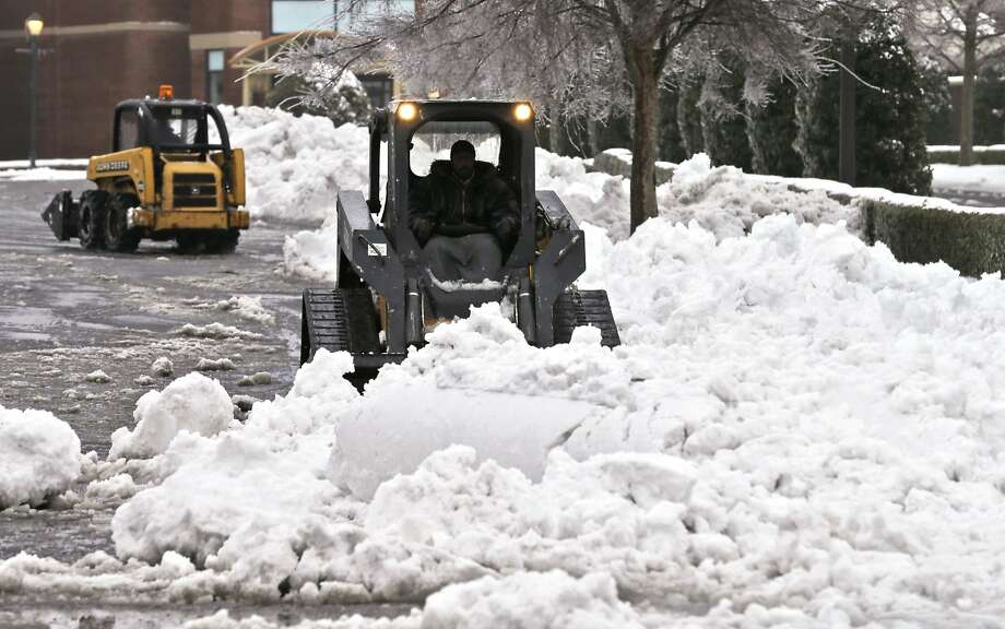 Recent bad weather, like the snow at this Richmond, Va., shopping center, has hurt sales. Photo: Steve Helber, Associated Press