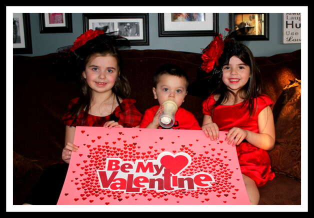 In true Valentines Day spirit, sisters Brianna and Brooke giving their baby brother Bryce some Valentine kisses. Photo: Picasa