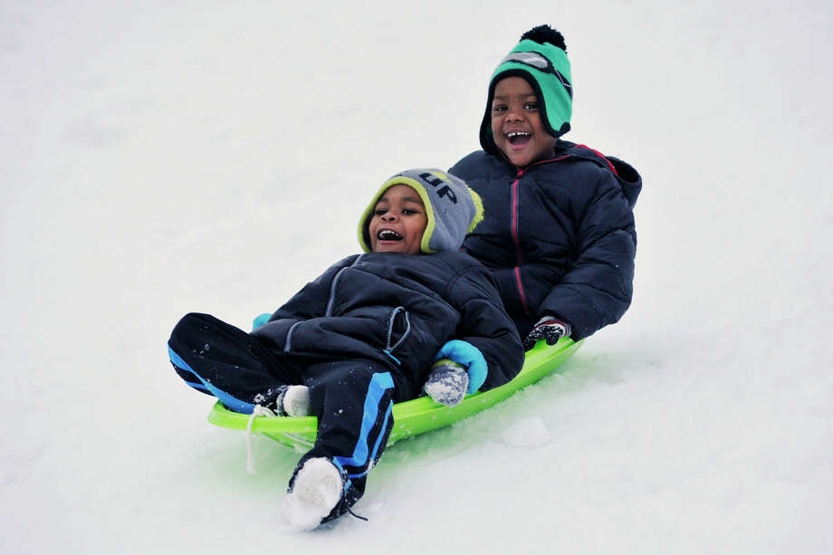 Zy'aire Pratt, front, and his brother, Artist Pratt sled together down a hill at Cummings Park during the snow storm in Stamford, Conn., on Thursday, Feb. 13, 2014. Photo: Jason Rearick / Stamford Advocate