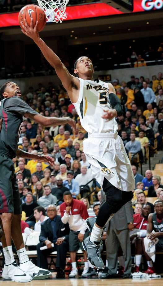 Missouri's Jordan Clarkson, right, drives past Arkansas' Rashad Madden, left, as he shoots during the first half of an NCAA college basketball game Thursday, Feb. 13, 2014, in Columbia, Mo. (AP Photo/L.G. Patterson) Photo: L.G. Patterson, Associated Press / FR23535 AP