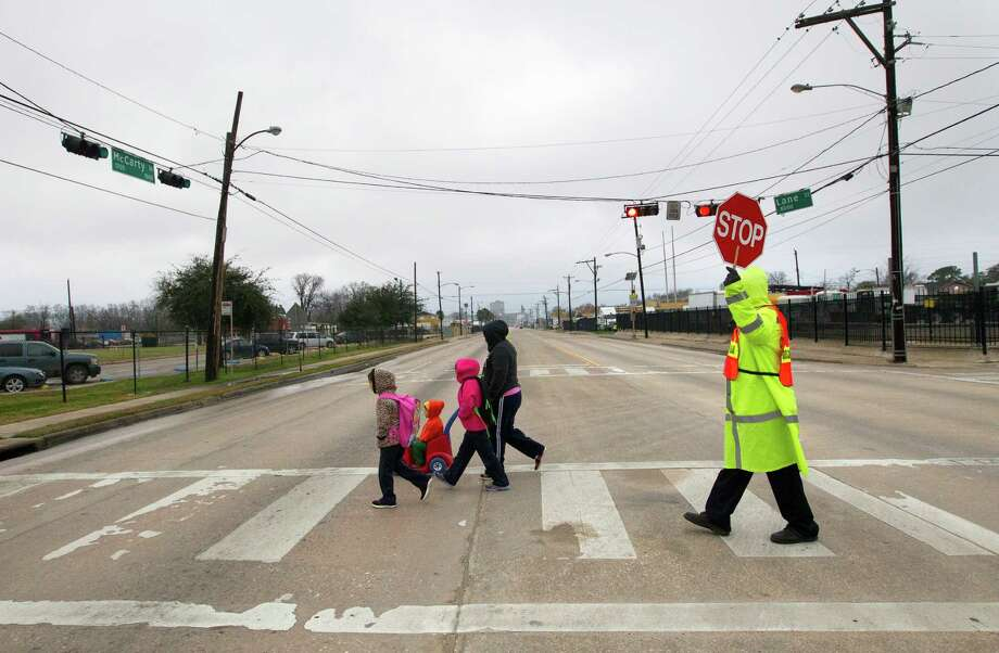 Yuridia Ortiz walks her children, Jaquelina, 8, left, Isaia, 3, and Jisel, 6, on Tuesday to Port Houston Elementary, a practice that could end if the campus is closed and her children are rezoned to a school farther away. Photo: Cody Duty, Staff / © 2013 Houston Chronicle