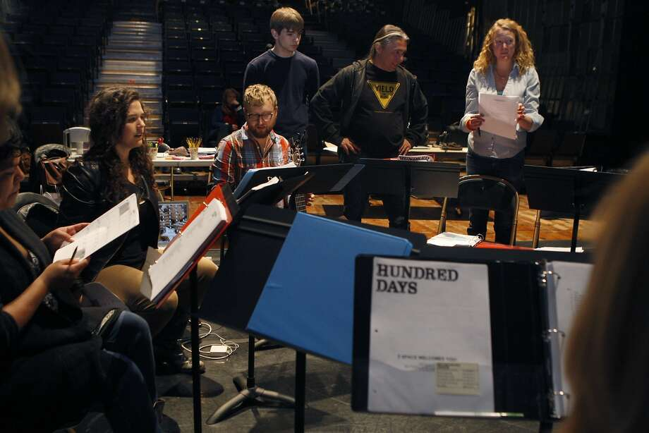 "Composer-performer-creators Abigail Bengson (left, seated) and Shaun Bengson (center, seated) prepare for a rehearsal of the musical-concert hybrid ""Hundred Days."" Photo: Liz Hafalia, The Chronicle"