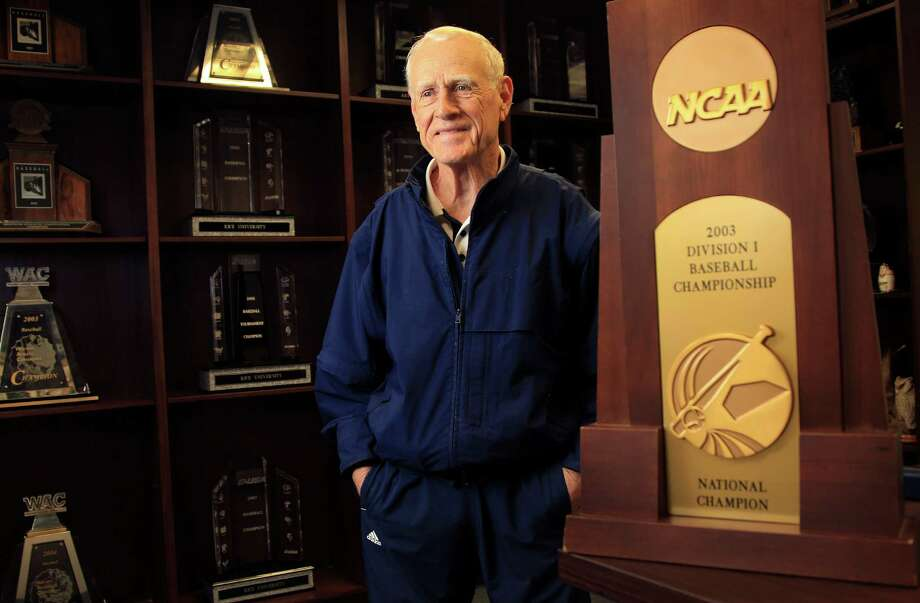 Wayne Graham savors Rice's 2003 national championship trophy, and an entire wall is needed to commemorate all the league titles. Photo: Karen Warren, Staff / © 2013 Houston Chronicle