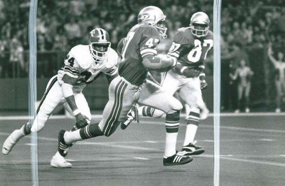 Oh, and buy an item of clothing with the old-school Seahawks logo so as not to appear to be a bandwagon jumper.Photo:  In the Seahawks' inaugural season, 1976, the home uniforms consisted of a blue jersey and gray striped pants. Players wore their number on their sleeves, which had stripes but no Seahawks logo. Photo: Grant M. Haller, Seattle P-I File