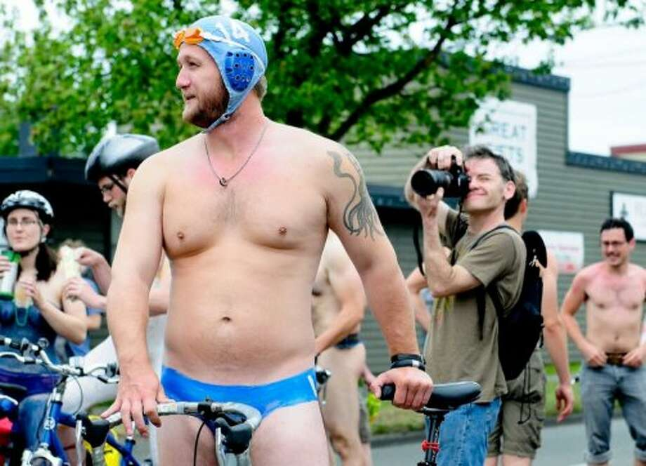 Speaking of bikes, act like you're just dying to get naked and ride one in a parade.  Photo: LINDSEY WASSON, Seattlepi.com