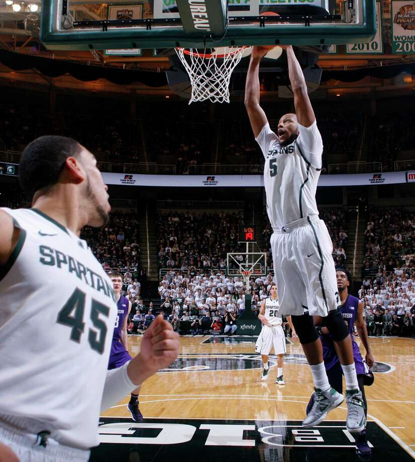 Michigan State's Adreian Payne (5) goes up for a dunk against Northwestern as Michigan State's Denzel Valentine (45) watches during the first half of an NCAA college basketball game, Thursday, Feb. 13, 2014, in East Lansing, Mich. (AP Photo/Al Goldis) ORG XMIT: ELJ104 Photo: Al Goldis / FR11125 AP