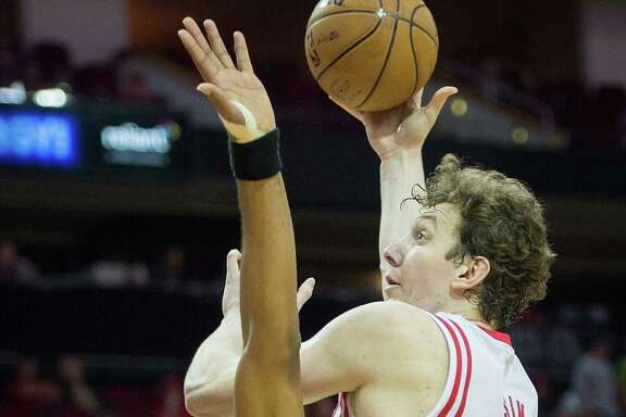 Houston Rockets center Omer Asik (3) shoots over Portland Trail Blazers power forward LaMarcus Aldridge (12) during the first half of an NBA basketball game at Toyota Center on Friday, Feb. 8, 2013, in Houston. ( Smiley N. Pool / Houston Chronicle )
