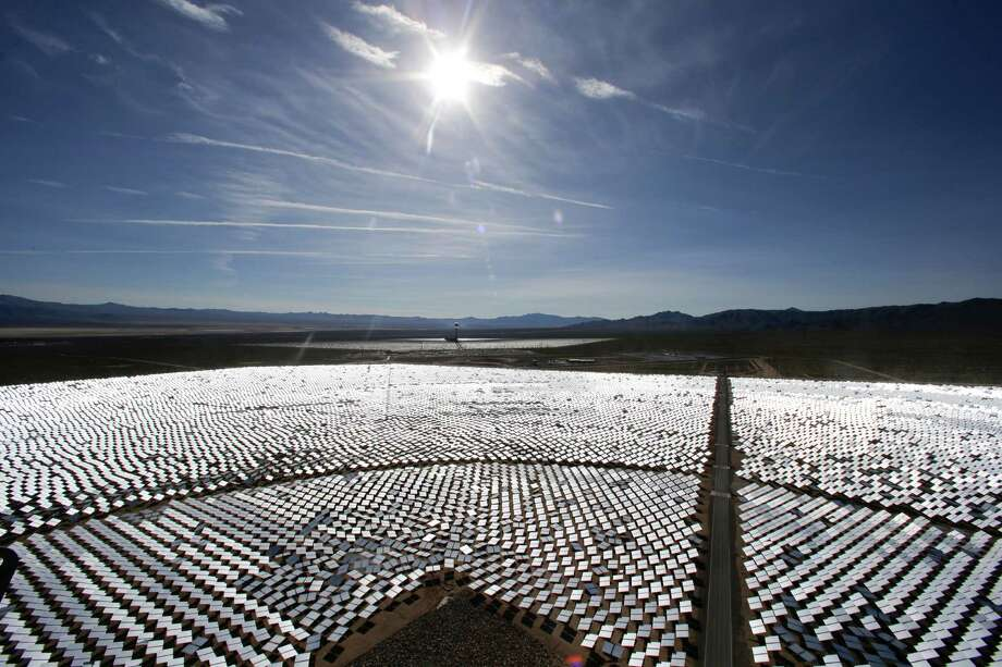 Some of the 300,000 computer-controlled mirrors, each about 7 feet high and 10 feet wide, reflect sunlight to boilers that sit on 459-foot towers. The Ivanpah Solar Electric Generating System, sprawls across roughly 5 square miles of federal land near the California-Nevada border. Photo: Chris Carlson, AP / AP