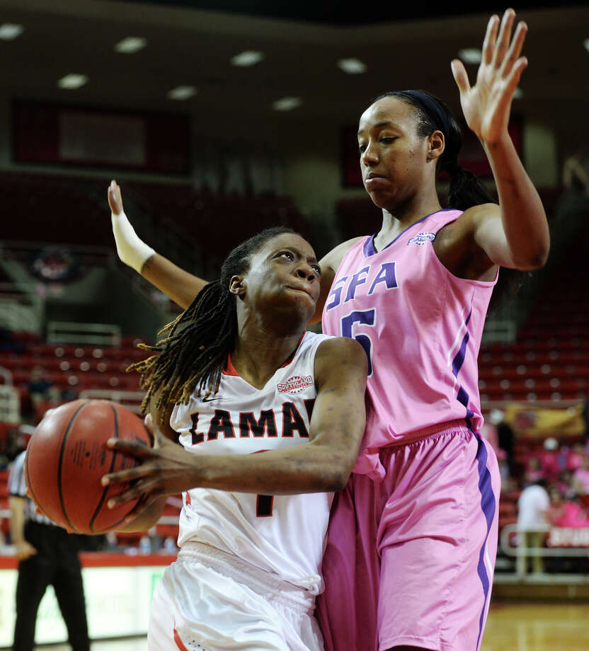 Lamar's Gia Ayers, No. 1, muscles past SFA's Porsha Roberts, No. 5, on her way to the basket. Lamar University played against Stephen F. Austin at the Montagne Center on Thursday night. Photo taken Thursday, 2/13/14 Jake Daniels/@JakeD_in_SETX Photo: Jake Daniels / ©2013 The Beaumont Enterprise/Jake Daniels