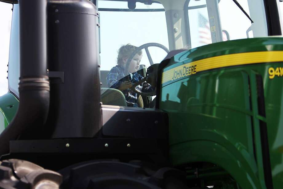 A boy sits at the wheel of a John Deere 9410R tractor at the 47th Annual World Ag Expo in Tulare, California February 13, 2014. The expo takes place as a third year of drought plagues California farmers with the driest year on record and prompting California Governor Jerry Brown to declare a state wide drought emergency.  REUTERS/David McNew (UNITED STATES - Tags: AGRICULTURE BUSINESS ENVIRONMENT) Photo: David Mcnew, Reuters