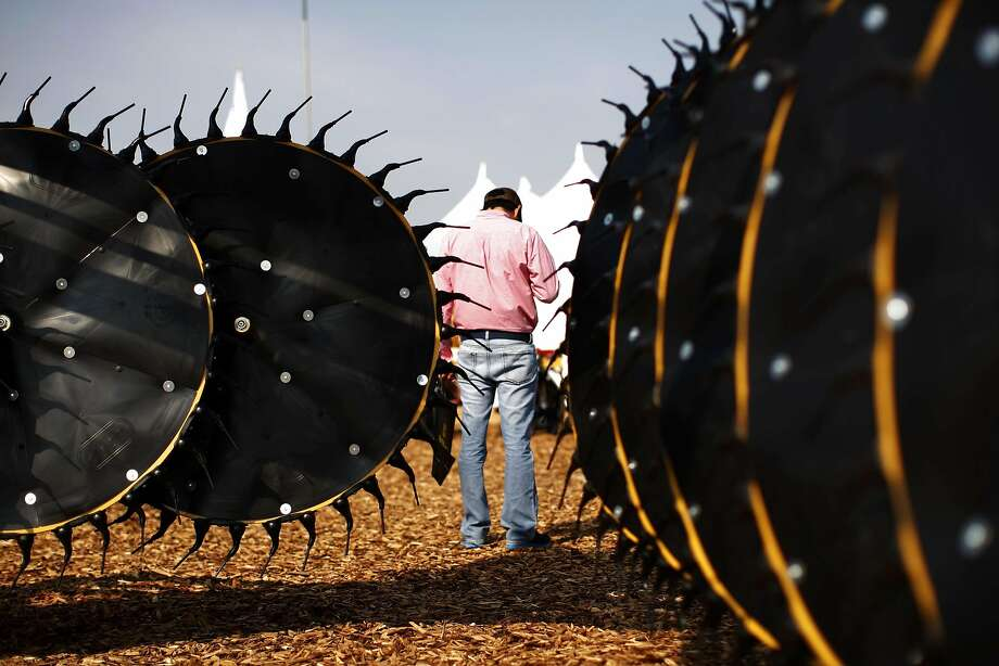 A man stands near hay rakers at the DARF Hay Rakes exhibit at the 47th Annual World Ag Expo in Tulare, California February 13, 2014. The expo takes place as a third year of drought plagues California farmers with the driest year on record and prompting California Governor Jerry Brown to declare a state wide drought emergency.  REUTERS/David McNew (UNITED STATES - Tags: ENVIRONMENT AGRICULTURE BUSINESS) Photo: David Mcnew, Reuters