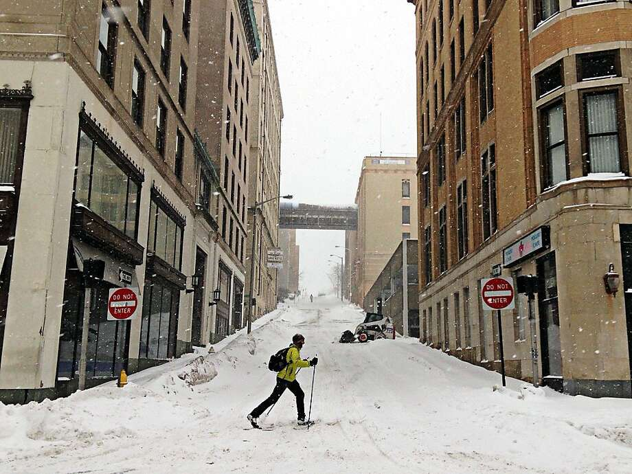 A cross country skier makes fast time on Main Street at Walnut Street in Worcester during the snowstorm on Feb. 13, 2014.  (AP Photo/Worcester Telegram & Gazette, Christine Peterson) Photo: Christine Peterson, Associated Press