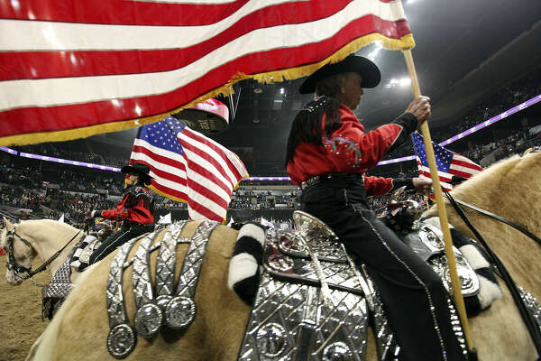 Palomino Patrol trot into rodeo arena on vintage silver
