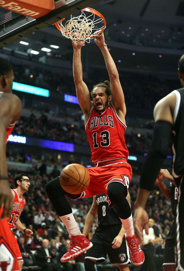 Chicago center Joakim Noah, who had 14 points, 13 rebounds, seven assists and two blocked shots, dunks in the first half of the Bulls' 92-76 victory over the Nets. Photo: Chris Sweda, McClatchy-Tribune News Service