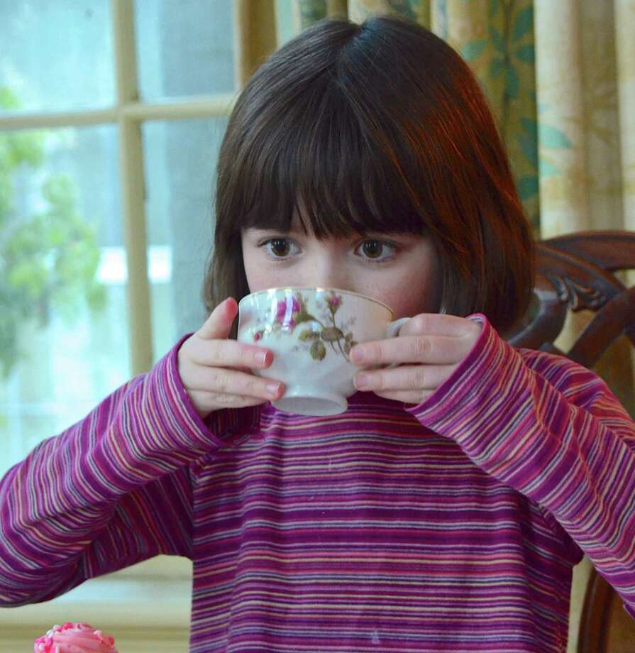 Carolina Barry enjoys her tea at the annual New Canaan Historical Society Valentine's Day Tea for children on February 11, 2014. Photo: Jeanna Petersen Shepard / New Canaan News Freelance