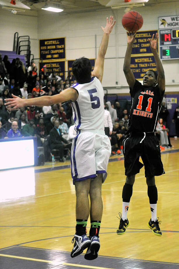 Stamford's Ancel Nevers puts up a shot in front of a leaping Evan Skoparantzas, of Westhill, during their basketball game at Westhill High School in Stamford, Conn., on Wednesday, Feb. 12, 2014. Photo: Jason Rearick / Stamford Advocate