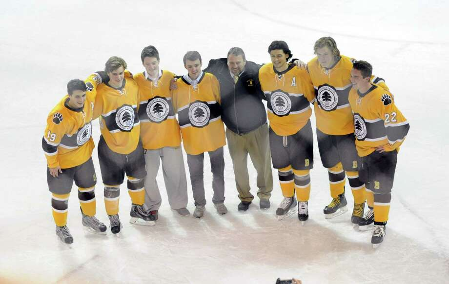 Brunswick School Hockey Coach, Ron VanBelle, center, poses with his senior players inbetween periods during the high school ice hockey game between Brunswick School and Albany Academy at Brunswick in Greenwich, Conn., Wednesday, Feb. 12, 2014. Photo: Bob Luckey / Greenwich Time