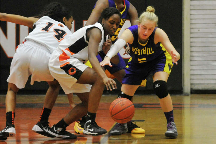 Stamford's Camry Evans and Westhill's Stephanie Roones compete for the loose ball during their basketball game at Stamford High School in Stamford, Conn., on Wednesday, Feb. 12, 2014. Photo: Jason Rearick / Stamford Advocate