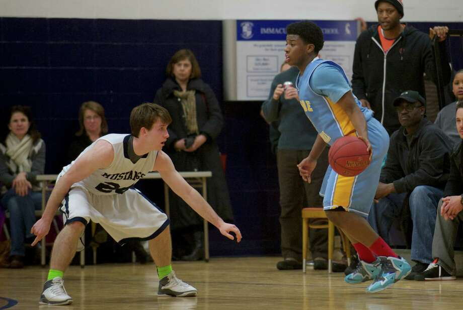 Boys basketball game between Kolbe Cathedral and Immaculate High School, played at Immaculate, in Danbury, Conn, on Friday night, February 7, 2014. Photo: H John Voorhees III / The News-Times Freelance