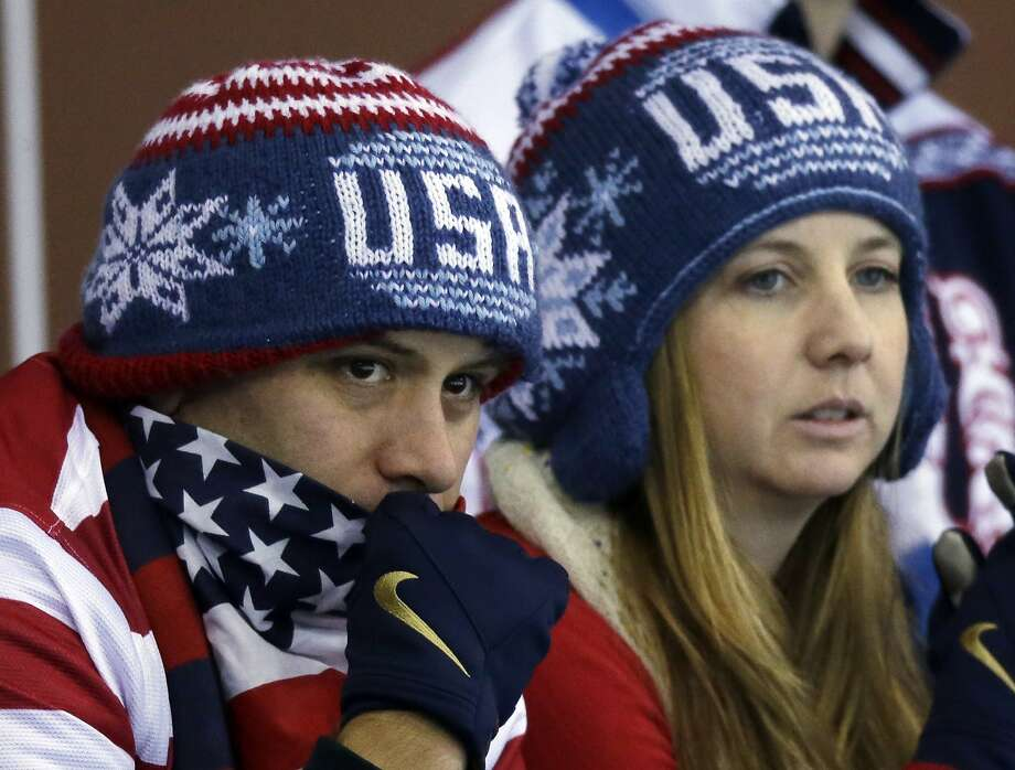 Some USA fans watch the round robin women's curling match between the United States and Denmark at the 2014 Winter Olympics, Friday, Feb. 14, 2014, in Sochi, Russia. Photo: Morry Gash, Associated Press