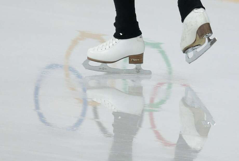 Kim Yuna of Korea skates at the figure skating practice rink at the 2014 Winter Olympics, Friday, Feb. 14, 2014, in Sochi, Russia. Photo: Ivan Sekretarev, Associated Press