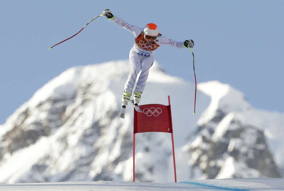 United States' Bode Miller makes a jump during the downhill portion of the men's supercombined at the Sochi 2014 Winter Olympics, Friday, Feb. 14, 2014, in Krasnaya Polyana, Russia. Photo: Charles Krupa, Associated Press