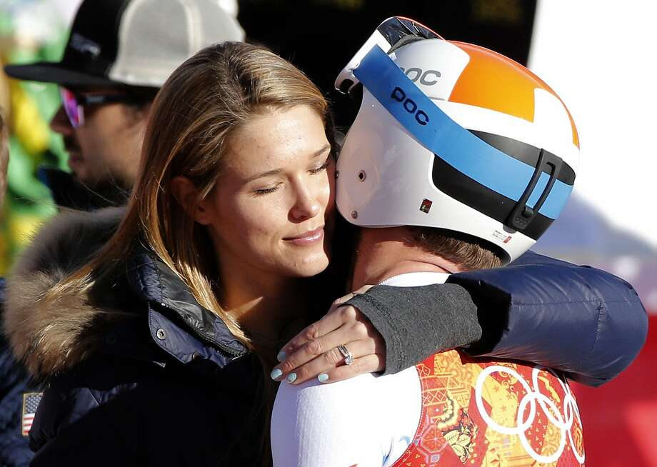 Mogan Miller embraces her husband, United States' Bode Miller after his run in the downhill portion of the men's supercombined at the Sochi 2014 Winter Olympics, Friday, Feb. 14, 2014, in Krasnaya Polyana, Russia. Photo: Christophe Ena, Associated Press